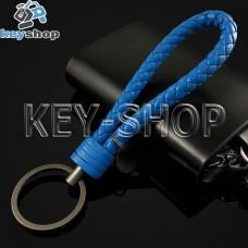 Синий брелок с кожаным плетёным шнуром и кольцом в темном хроме