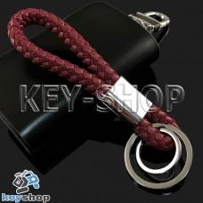 Красный брелок с кожаным плетёным шнуром и двумя кольцами