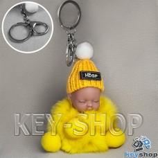 Желтый пушистый меховой брелок куколка, на сумку, рюкзак с кольцом и карабином