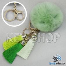Зеленый пушистый брелок шарик из натурального меха с кольцом, карабином и разноцветными кисточками, на сумку